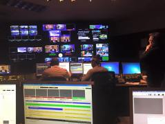 Reviewing video elements and rundown with director before taping of Full Measure broadcast.